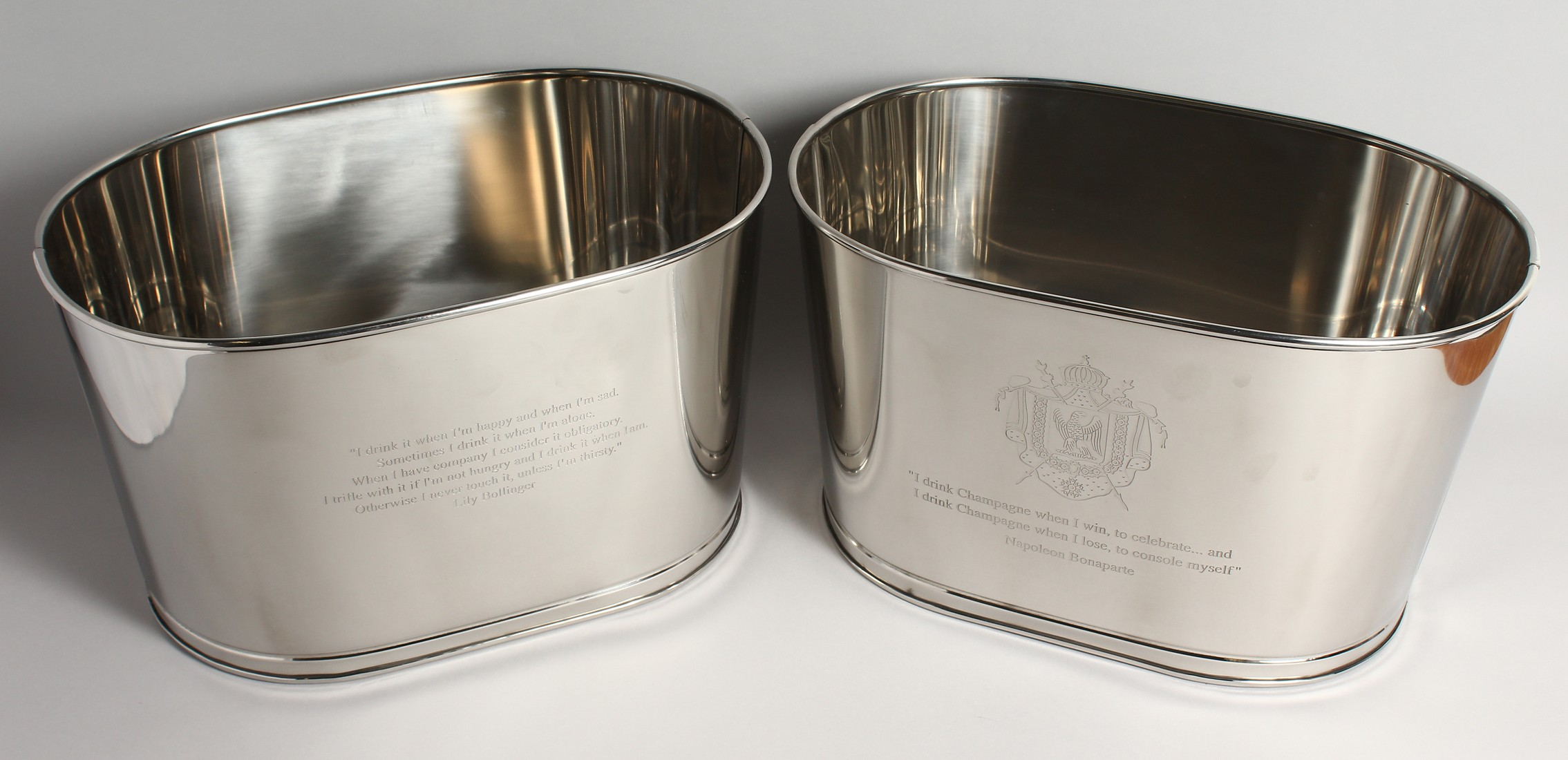 A PAIR OF PLATED OVAL WINE COOLERS 17ins long x 10ins high.