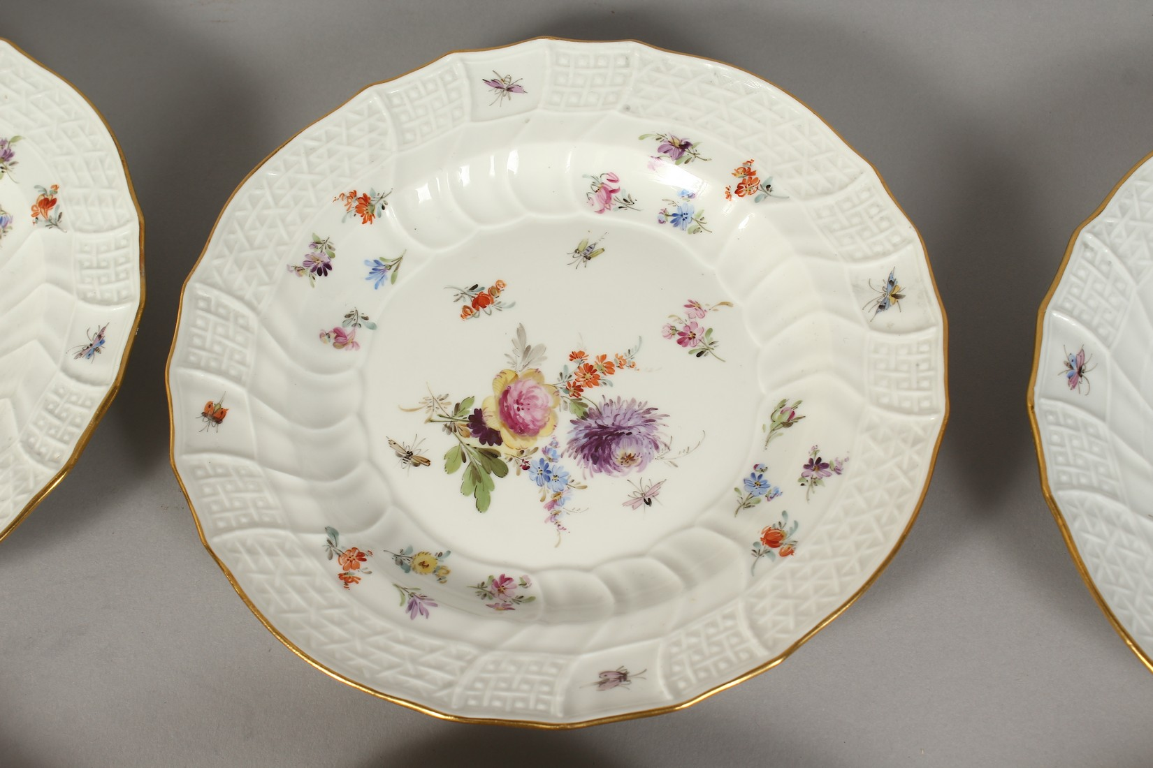 A SET OF EIGHT MEISSEN PORCELAIN DISHES with moulded gilt edged rim, each painted with flowers and - Image 8 of 11