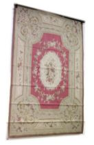 AN ABUSSON STYLE WALL HANGING/CARPET, 20TH CENTURY, pink ground within a beige ground border, with