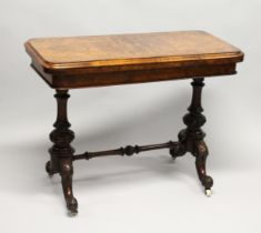 A GOOD VICTORIAN FIGURED WALNUT CARD TABLE, with folding rounded rectangular top, on a pair of