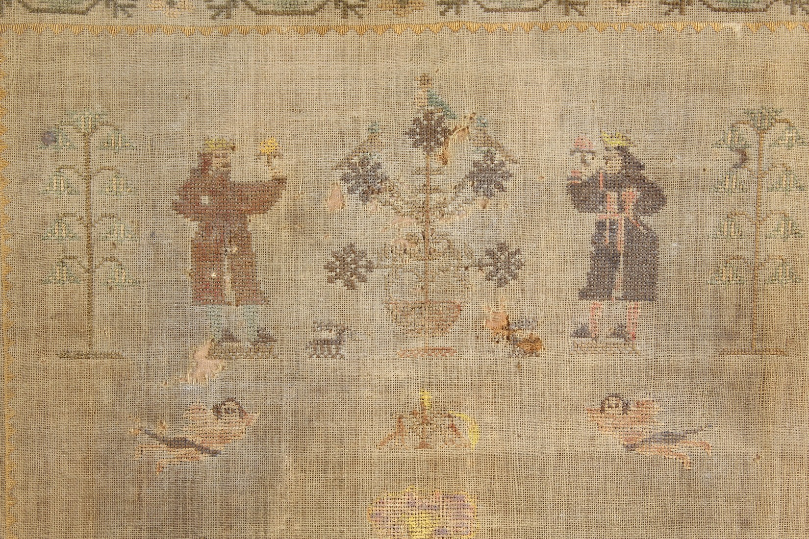 A 19TH CENTURY SAMPLER, depicting figures, flowers and a poem by Ann Powis dated 1837. 21.5ins and - Image 2 of 4
