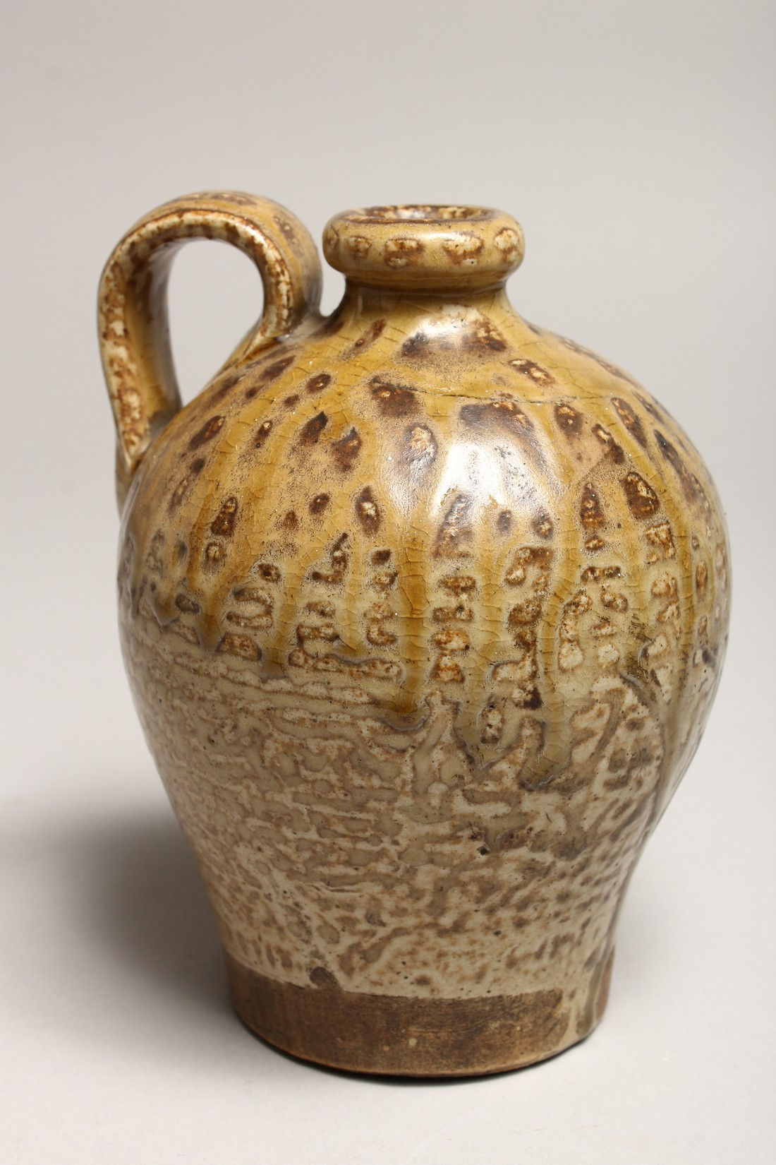 A ROMAN TYPE POTTERY JUG, See inscription on base 5.5ins high - Image 3 of 6