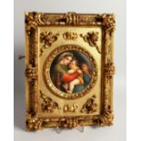 A GOOD GERMAN PORCELAIN CIRCULAR PLAQUE, Madonna and child 5.5ins diameter in a gilded frame.
