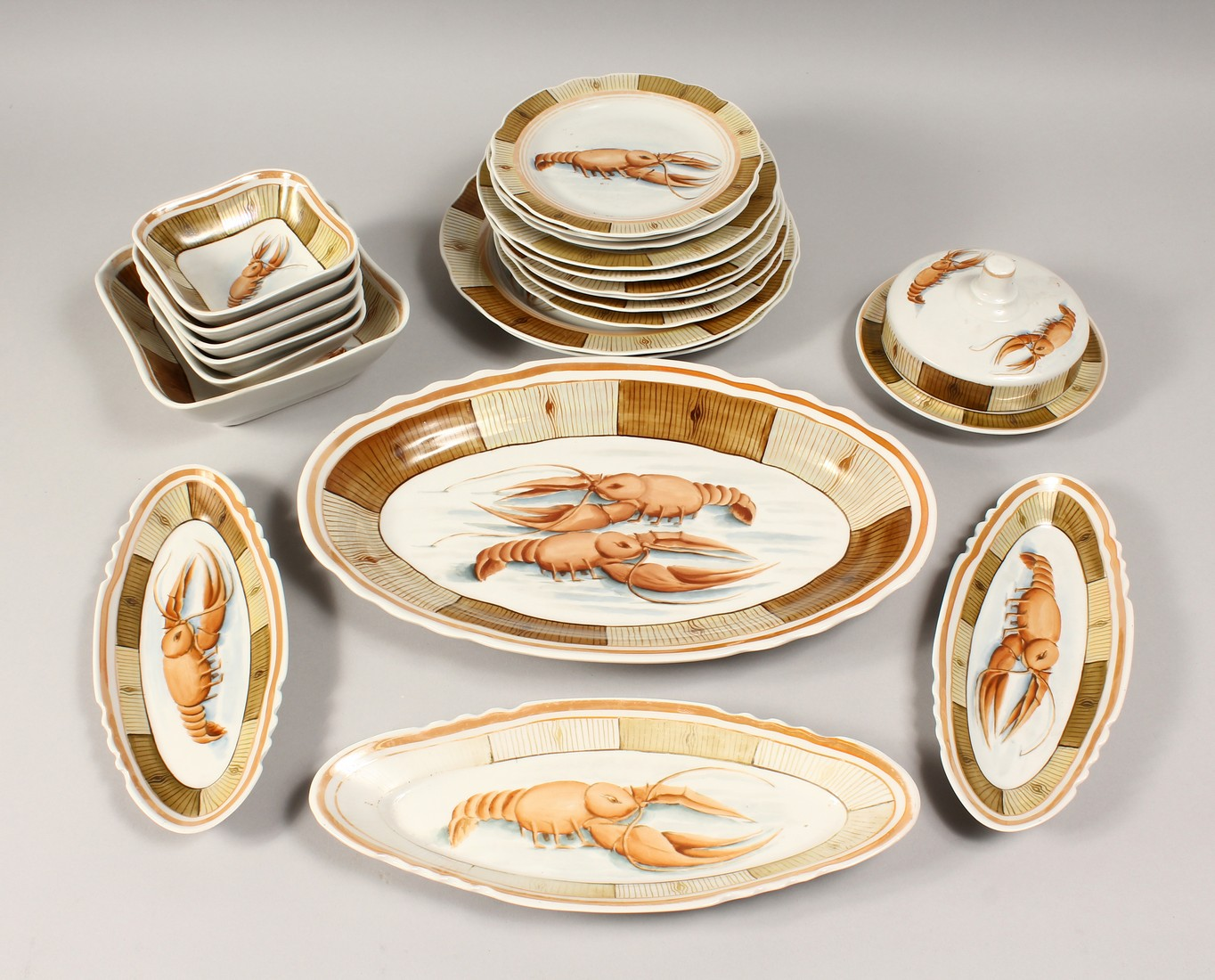 A RUSSIAN PORCELAIN SERVICE decorated with shell fish, comprising a pair of plates, 9.5ins diameter,