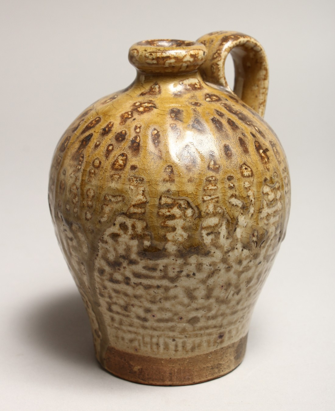 A ROMAN TYPE POTTERY JUG, See inscription on base 5.5ins high