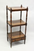 A 19TH CENTURY ROSEWOOD THREE TIER WHAT NOT, with turned columns and a small drawer, on brass