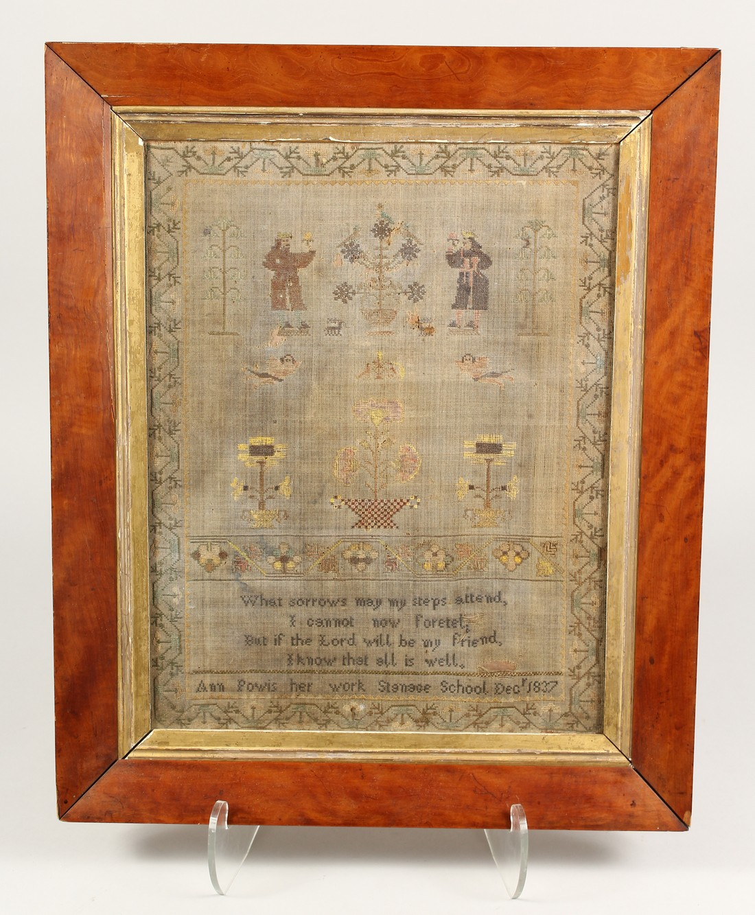 A 19TH CENTURY SAMPLER, depicting figures, flowers and a poem by Ann Powis dated 1837. 21.5ins and