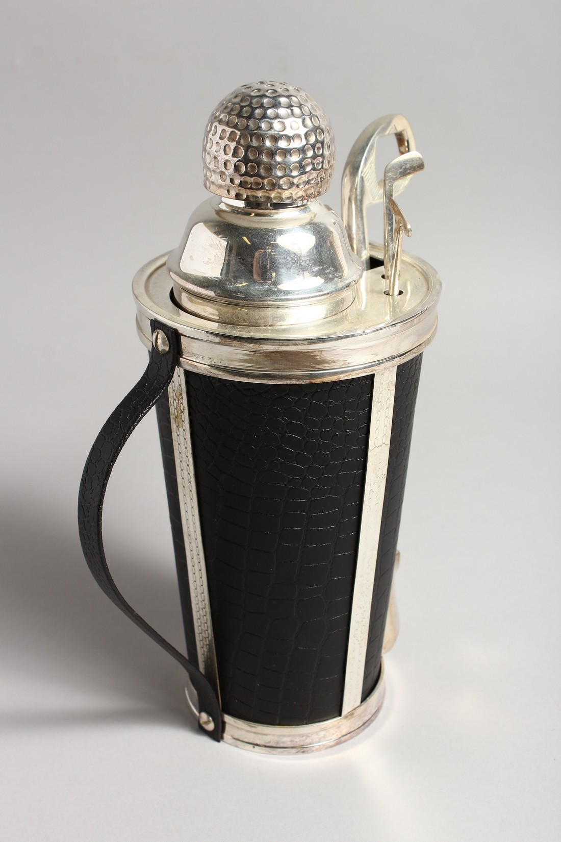 A SILVER PLATE AND LEATHER COVERED GOLF BAG COCKTAIL SHAKER with carrying handle. 11.5ins high. - Image 2 of 2
