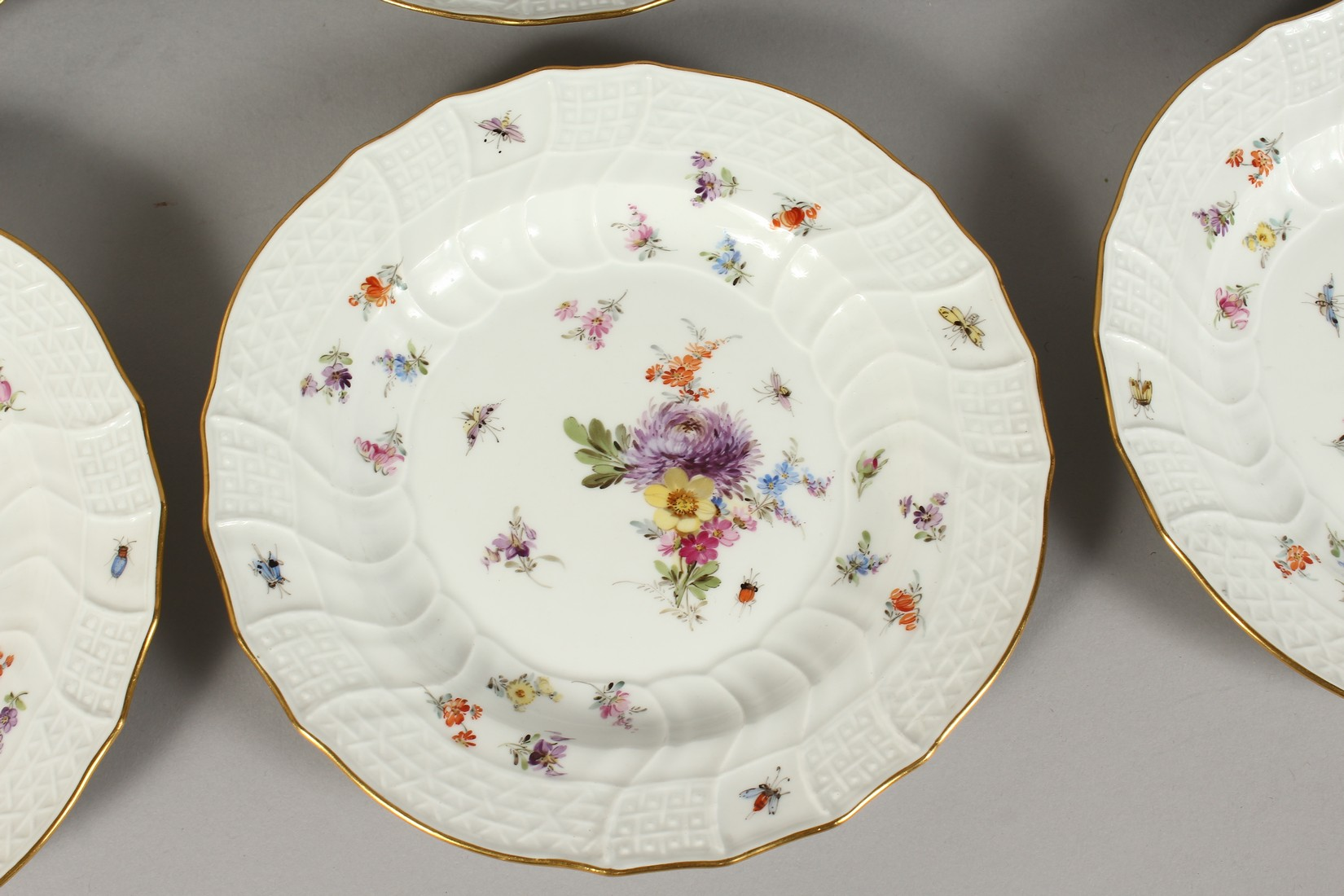 A SET OF EIGHT MEISSEN PORCELAIN DISHES with moulded gilt edged rim, each painted with flowers and - Image 3 of 11