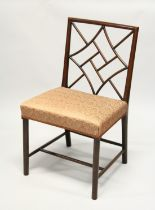 """A GEORGE III MAHOGANY """"COCKPEN"""" SIDE CHAIR with typical lattice back, overstuffed seat on plain"""