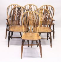 A GOOD SET OF SIX OAK AND ELM WINDSOR WHEEL BACK DINING CHAIRS, two with arms