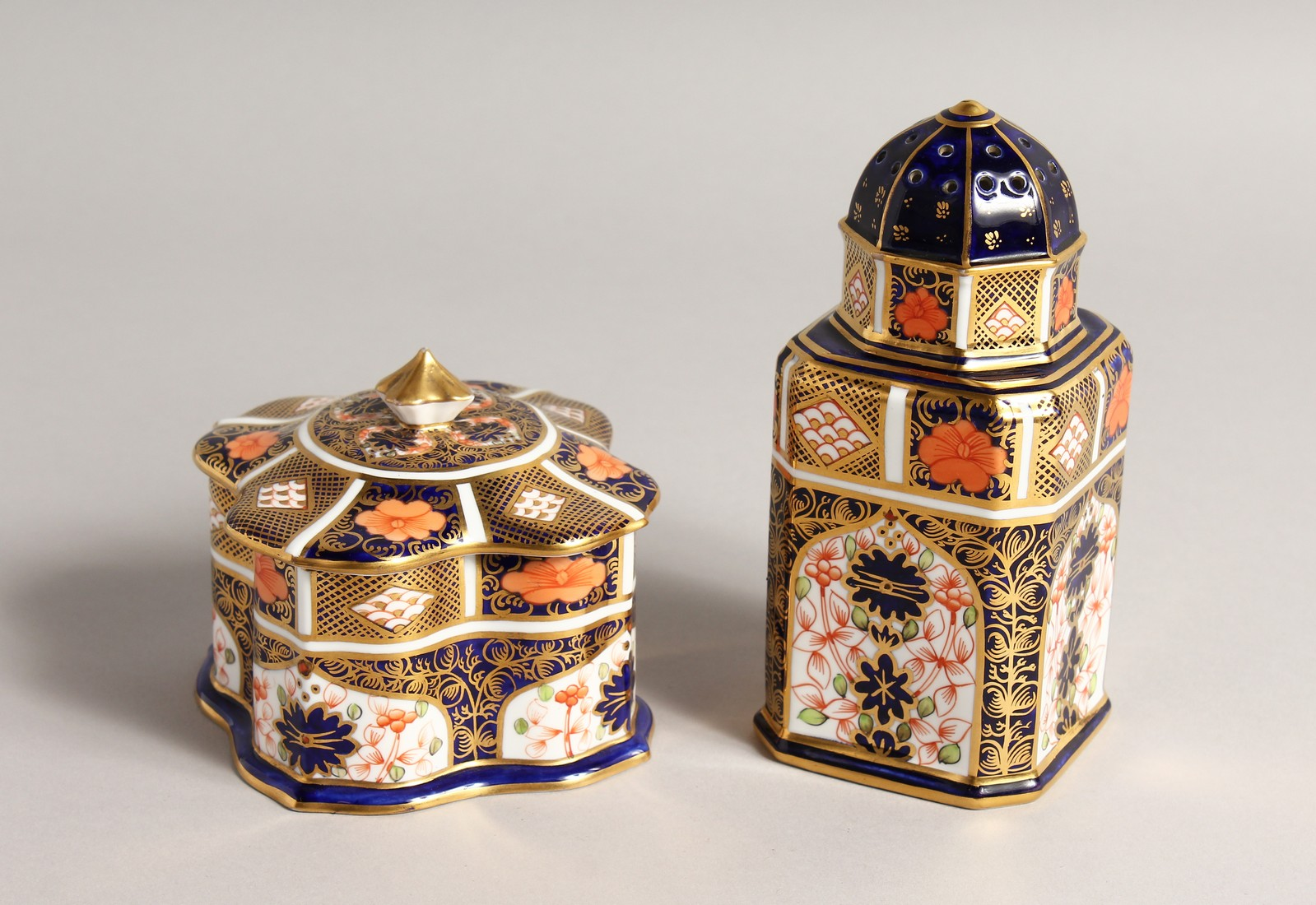 A ROYAL CROWN DERBY JAPAN PATTERN SQUARE SUGAR SIFTER, No. 1128. 6ins high and a SQUARE SUPERB BOX