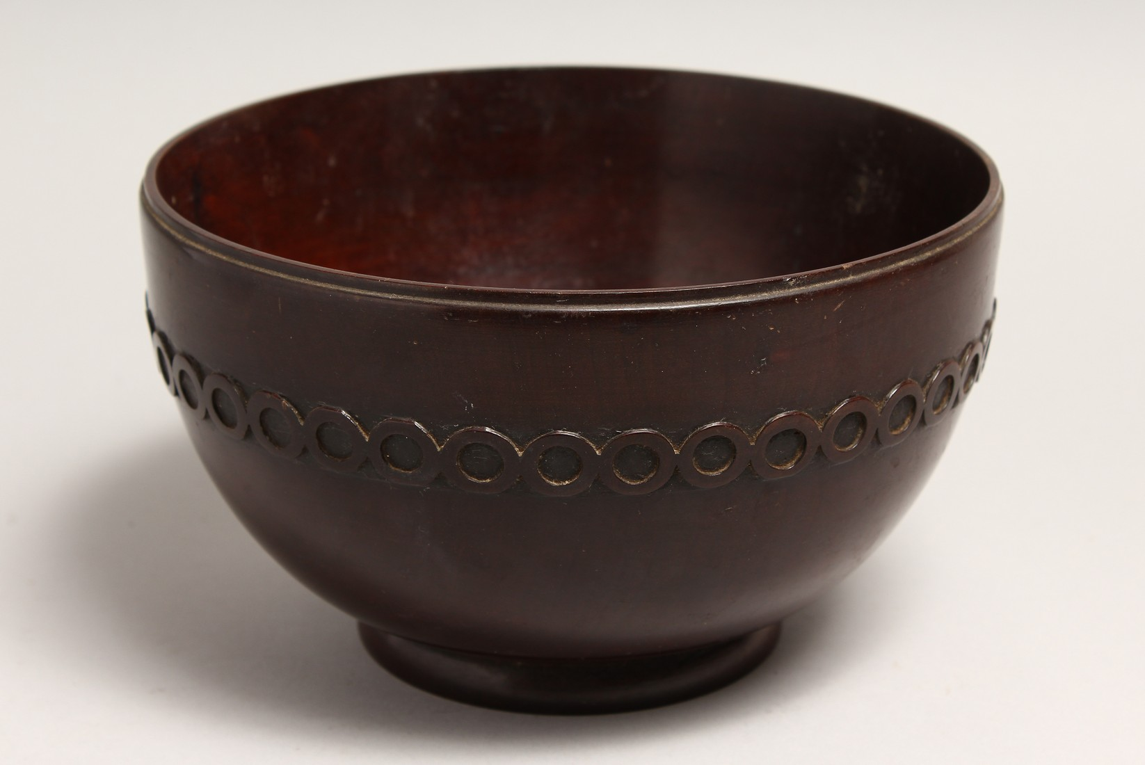 A GEORGIAN TURNED AND CARVED MAHOGANY CIRCULAR BOWL 8.5ins diameter 5ins high.