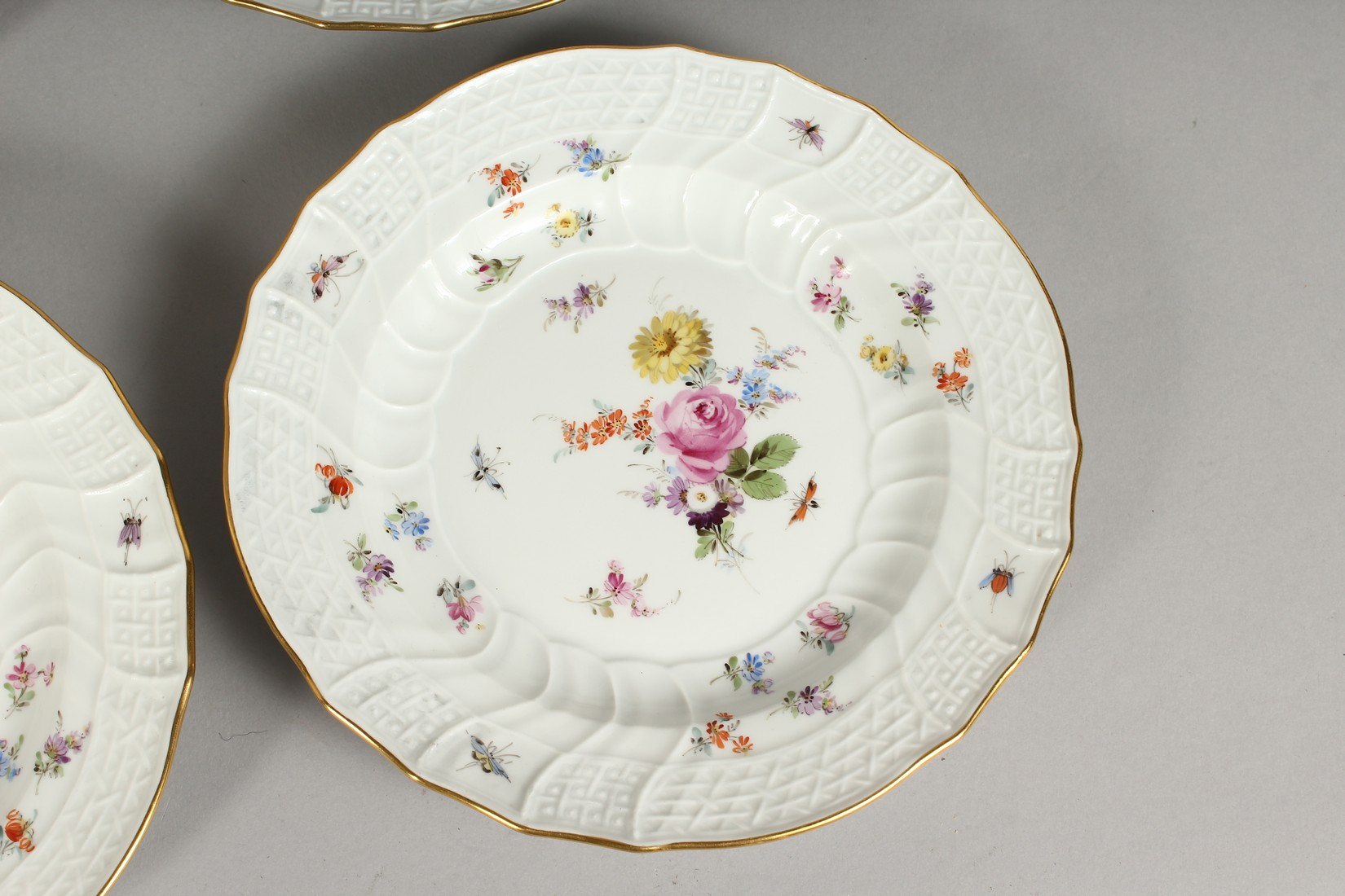 A SET OF EIGHT MEISSEN PORCELAIN DISHES with moulded gilt edged rim, each painted with flowers and - Image 5 of 11