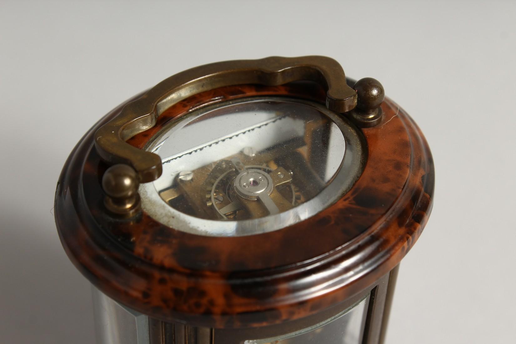 A GOOD CIRCULAR BRASS CARRIAGE CLOCK, MATTHEW NORMAN, LONDON. 3ins high - Image 2 of 7