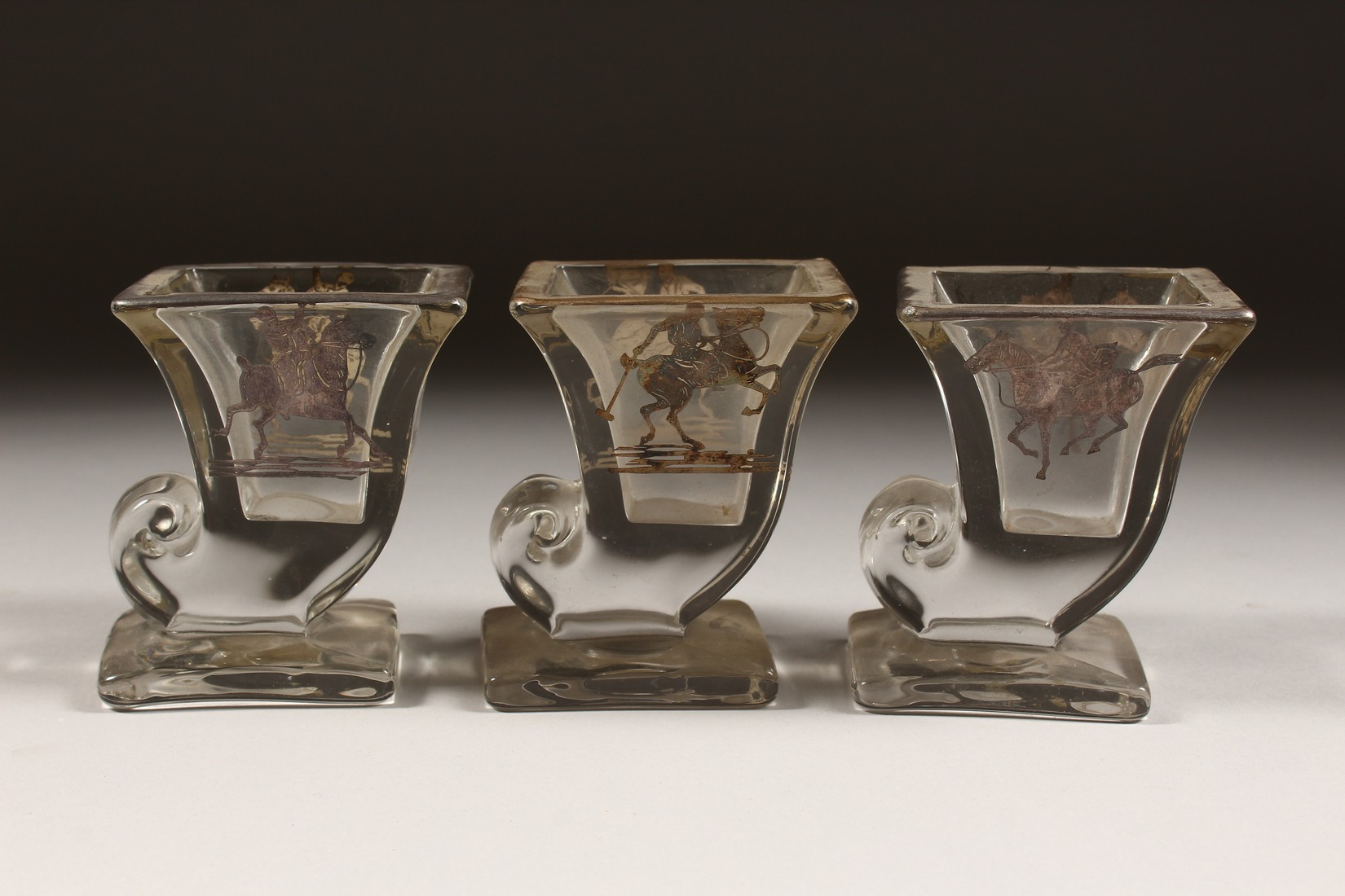 A SET OF THREE SILVER OVERLAY MOULDED GLASS SMALL VASES, decorated with polo players on horseback. - Image 3 of 5
