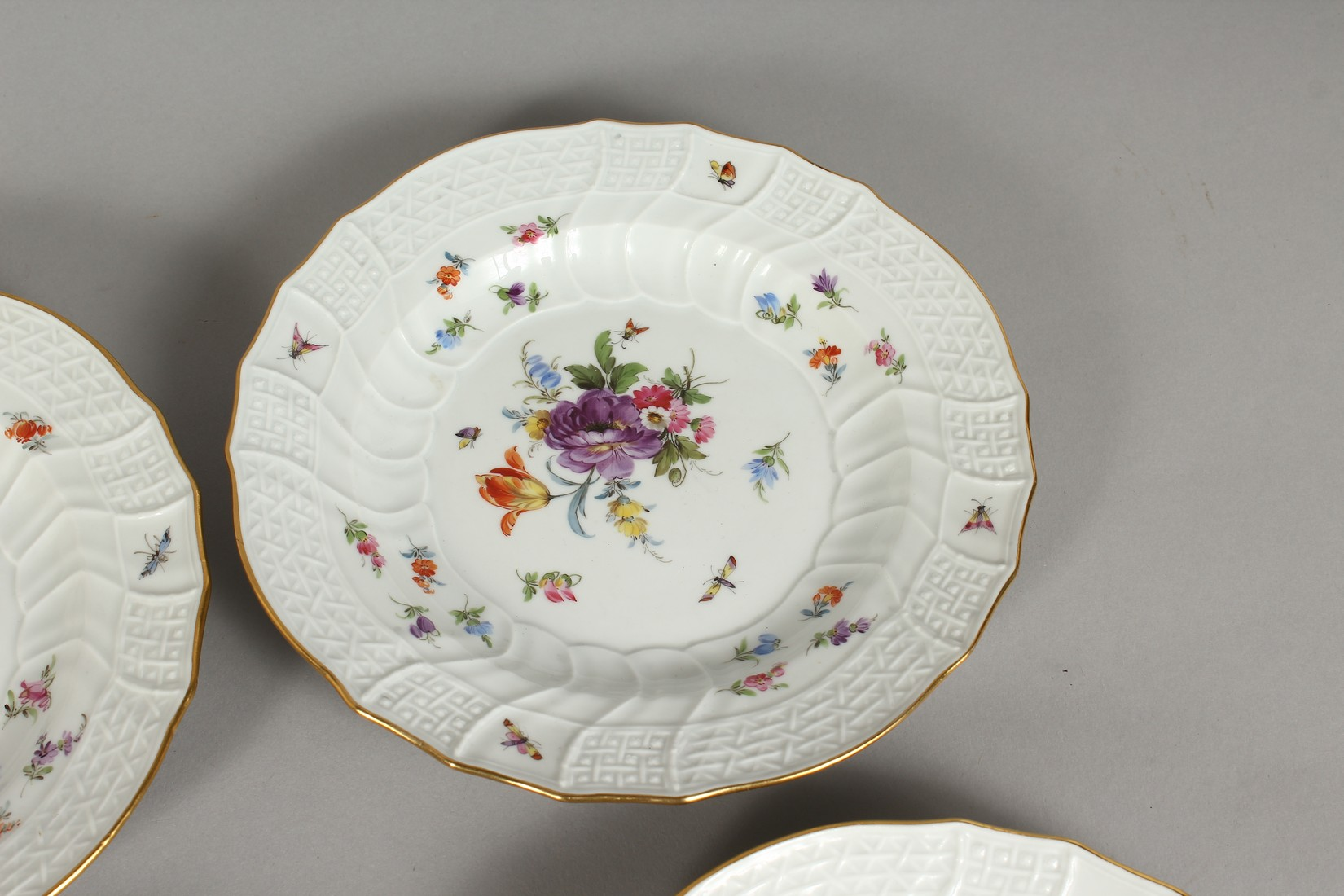 A SET OF EIGHT MEISSEN PORCELAIN DISHES with moulded gilt edged rim, each painted with flowers and - Image 6 of 11