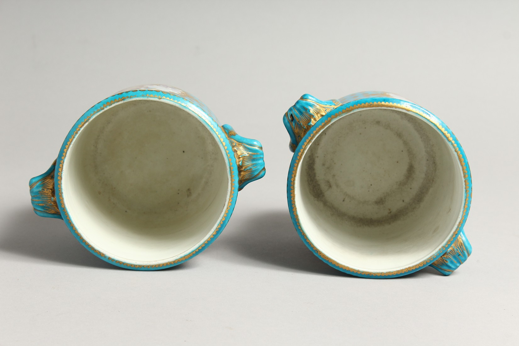 A GOOD PAIR OF SEVRES PORCELAIN CACHE POTS, blue groun painted with reverse panels of fruit. Mark in - Image 5 of 6