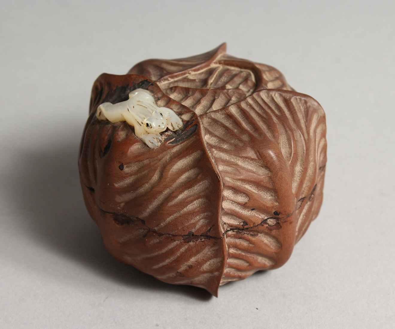 A JAPANESE WOOD CABBAGE BOX AND COVER with a mother of pearl frog 2.5ins