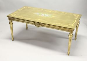 A 20TH CENTURY DECORATIVE GILTWOOD LOW TABLE, with floral painted decoration, on turned tapering