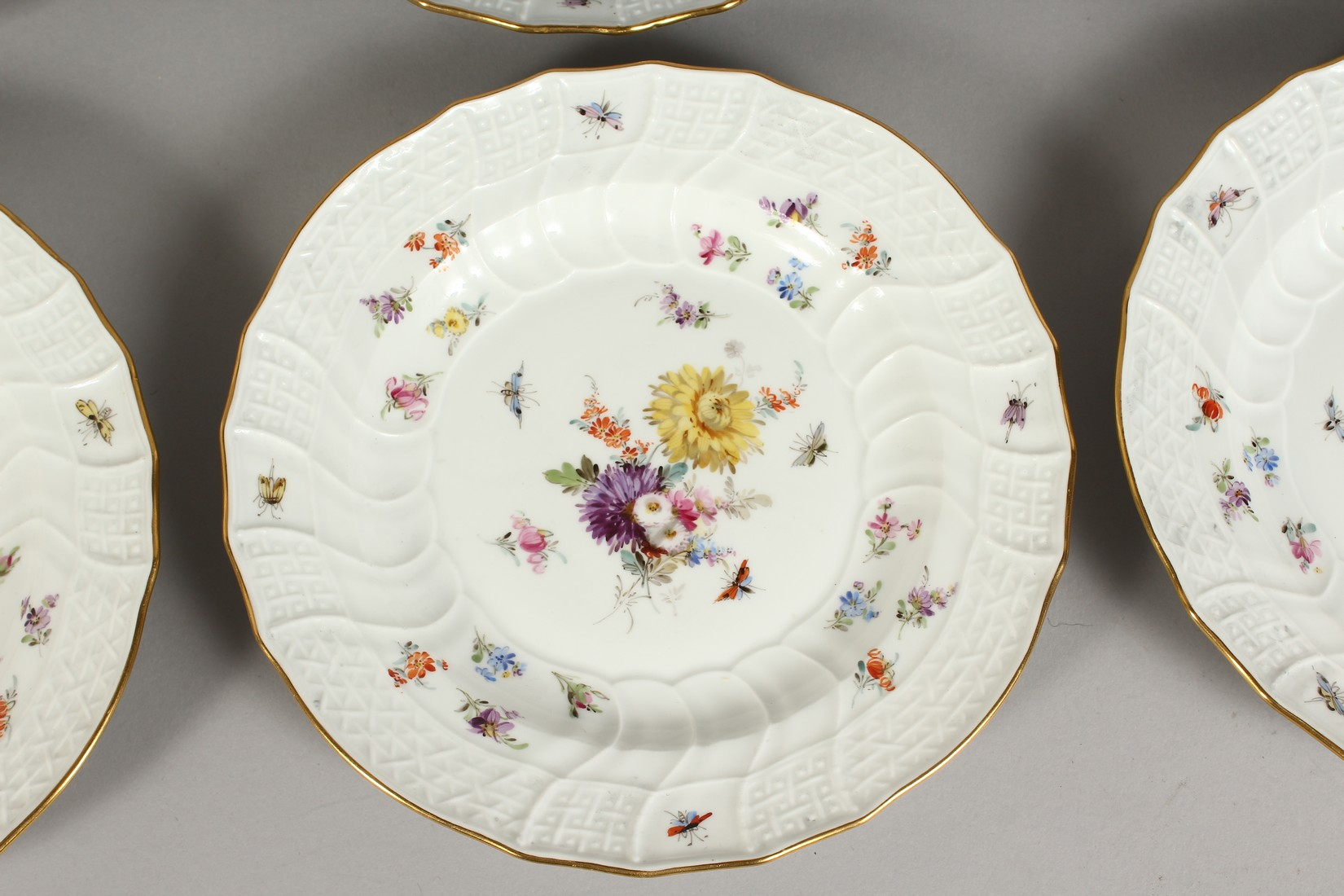 A SET OF EIGHT MEISSEN PORCELAIN DISHES with moulded gilt edged rim, each painted with flowers and - Image 4 of 11