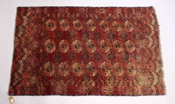 A GOOD EARLY 20TH CENTURY TURKMAN TEKKE RUG, claret ground with three rows of seven gulls. 5ft