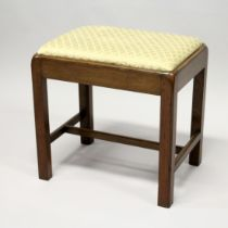 A GEORGE III MAHOGANY RECTANGULAR STOOL, with drop-in seat on moulded square legs united by