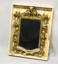 A VERY GOOD 19TH CENTURY FLORENTINE CARVED GILT WOOD MIRROR. 3ft 3ins high, 2ft 2ins wide overall.