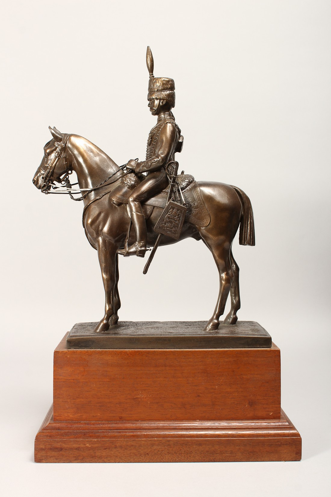 A BRONZE OVERLAID COMPOSITE MODEL OF A HUSSAR ON HORSEBACK, on a wooden plinth base 17ins high. - Image 2 of 4