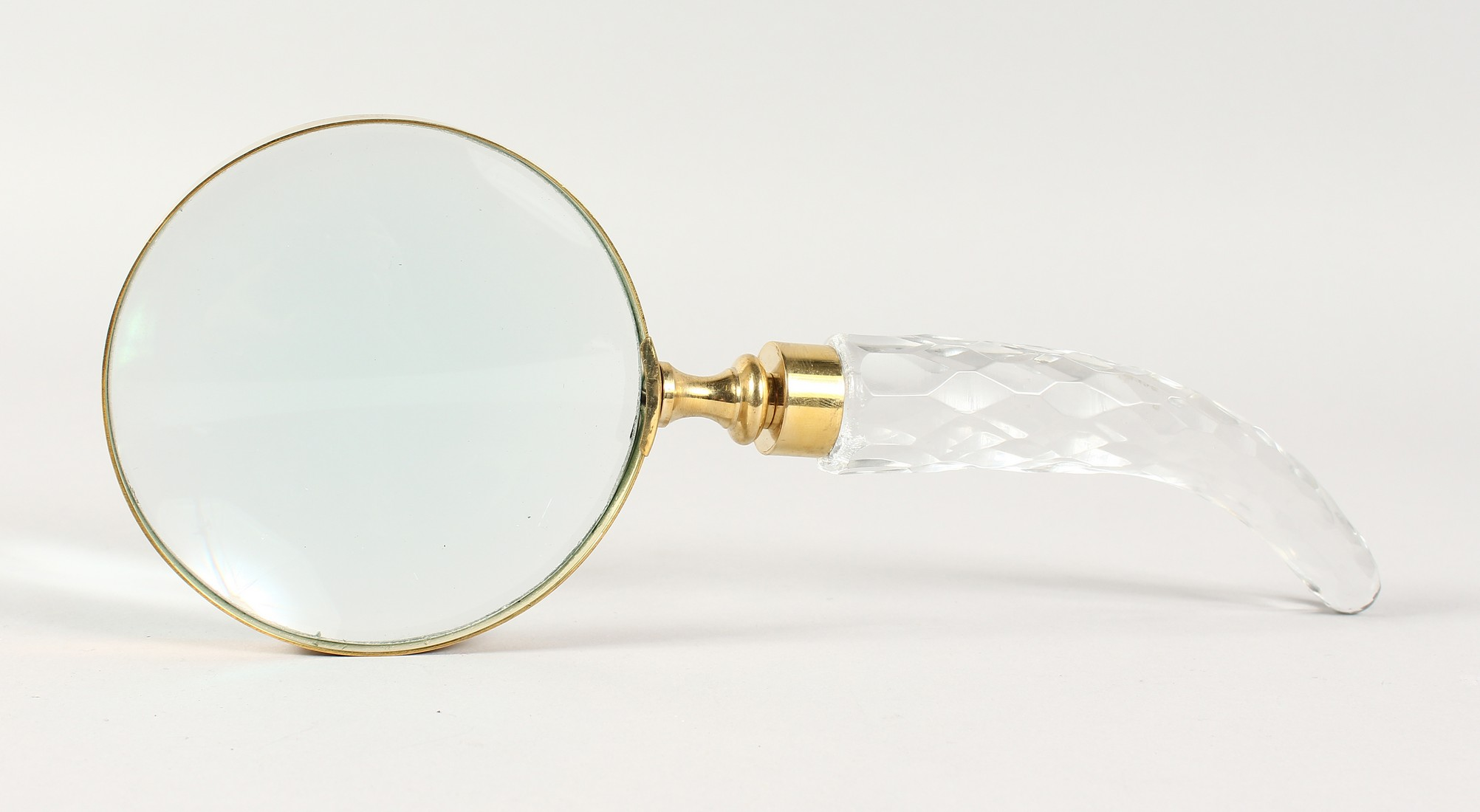 A CUT GLASS HANDLED MAGNIFYING GLASS