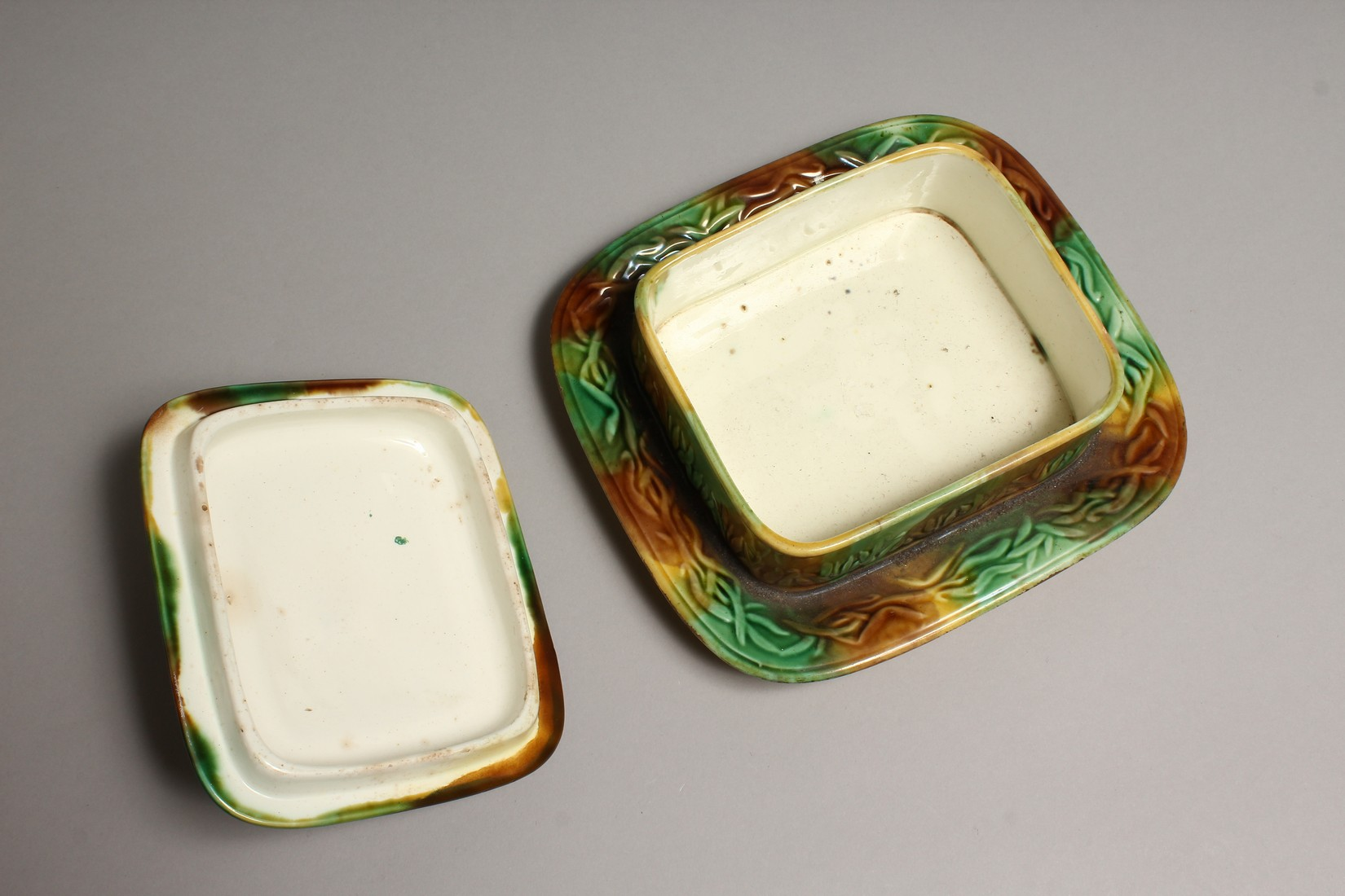 A MAJOLICA SARDINE DISH AND COVER, green and brown glaze with moulded decoration and shell handle. - Image 3 of 4