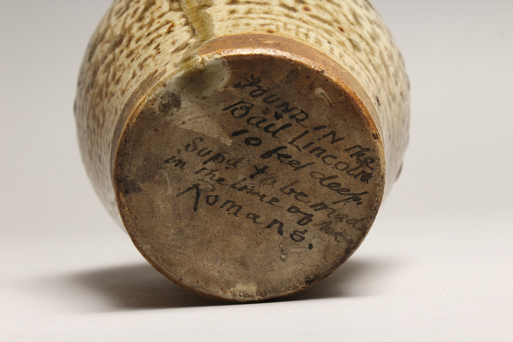 A ROMAN TYPE POTTERY JUG, See inscription on base 5.5ins high - Image 6 of 6