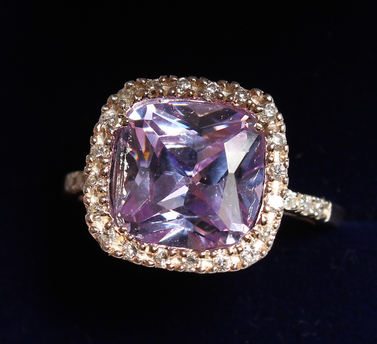 A SILVER CZ RING.