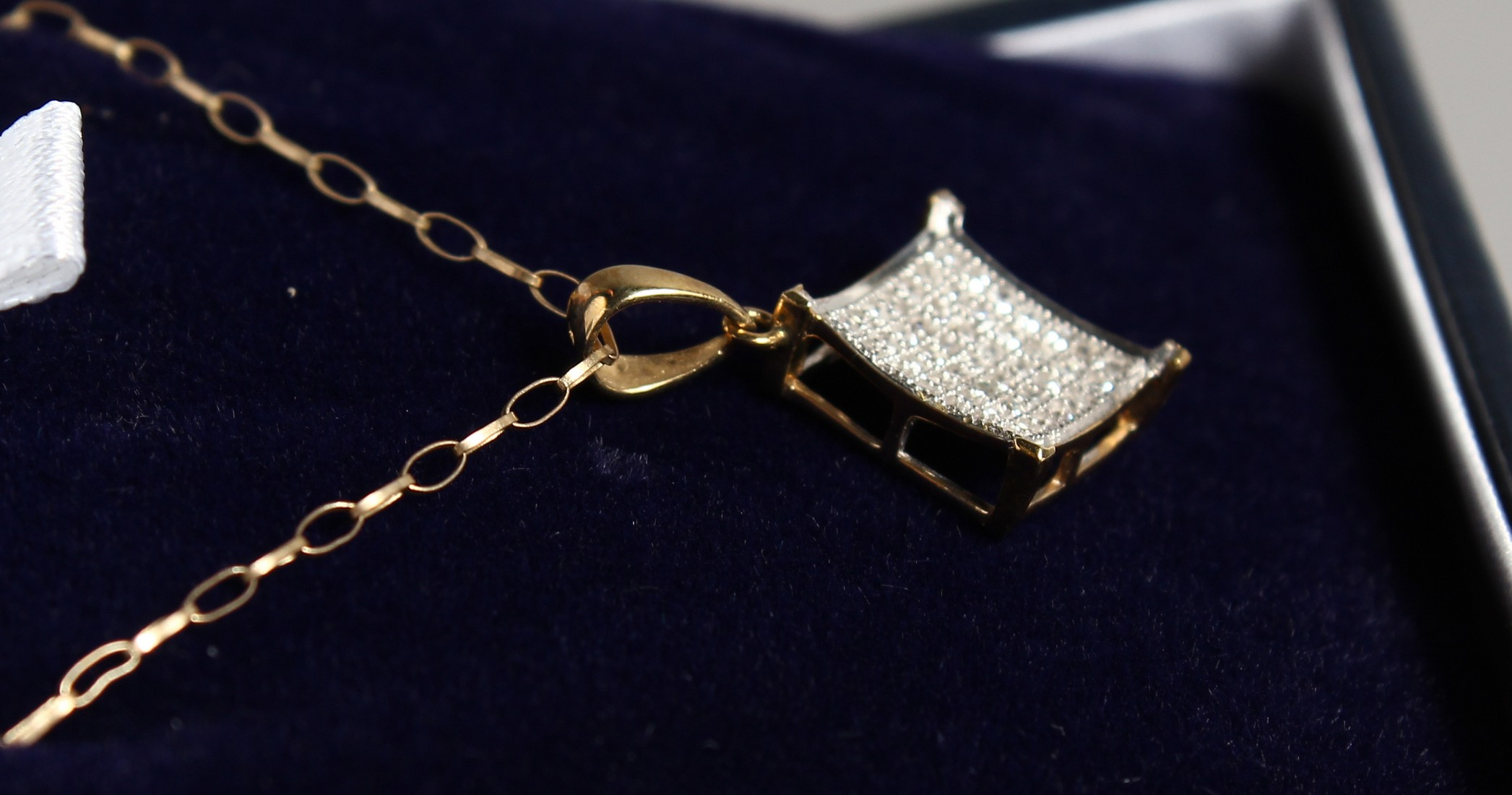 A 9CT GOLD AD DIAMOND PENDANT on a chain. - Image 2 of 2