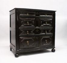 A GOOD LATE 17TH CENTURY, DARK OAK, TWO PIECE LINEN FOLD FRONT, CHEST OF FOUR DRAWERS with brass