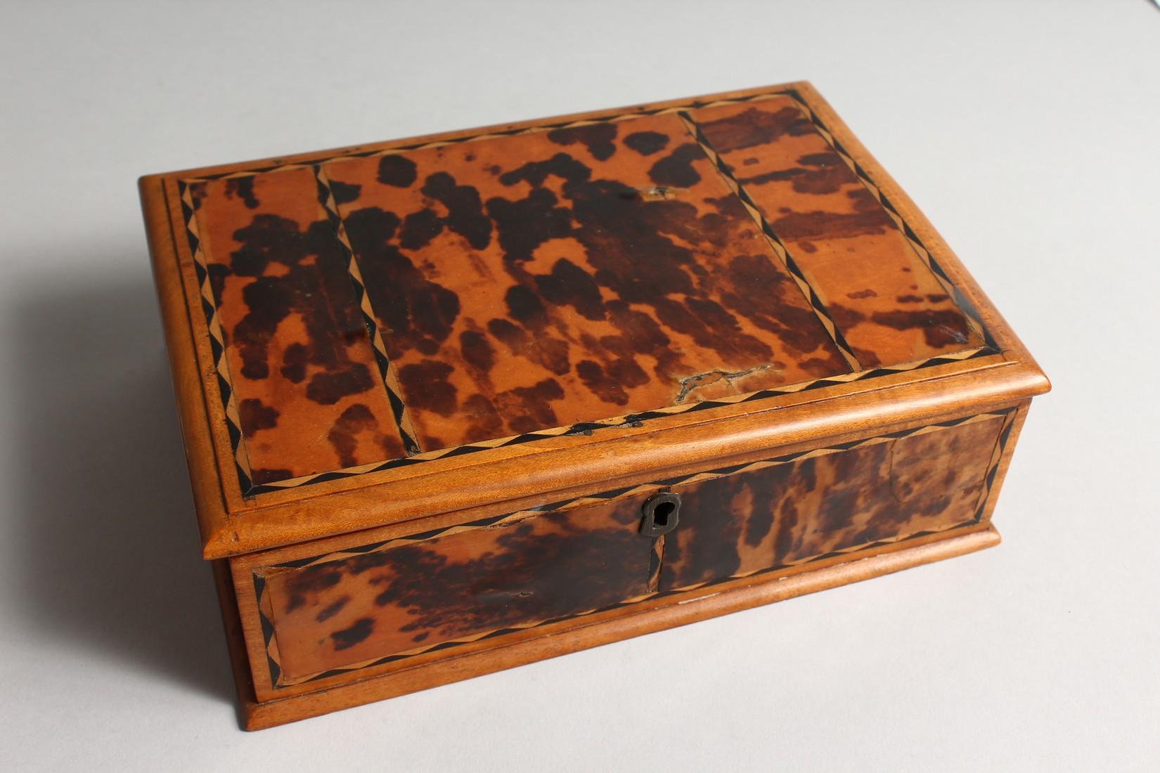 A TORTOISESHELL RECTANGULAR BOX AND COVER 8.5ins long.