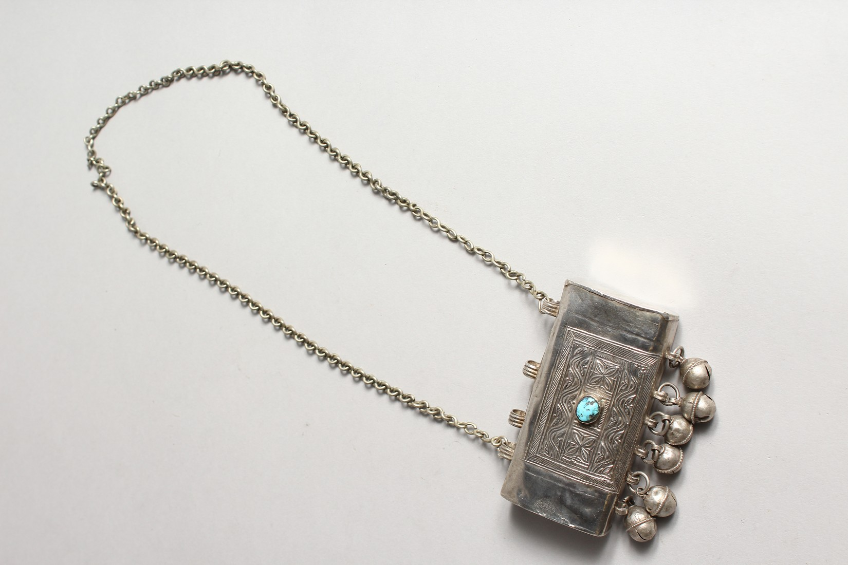 AN ISLAMIC SILVER BOX with bells, stone and chain - Image 2 of 3