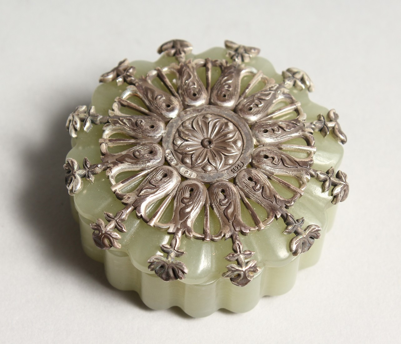 A GOOD JADE AND SILVER TOP BOX AND COVER the top stamped .925 and W. W. 84 2ins diameter.