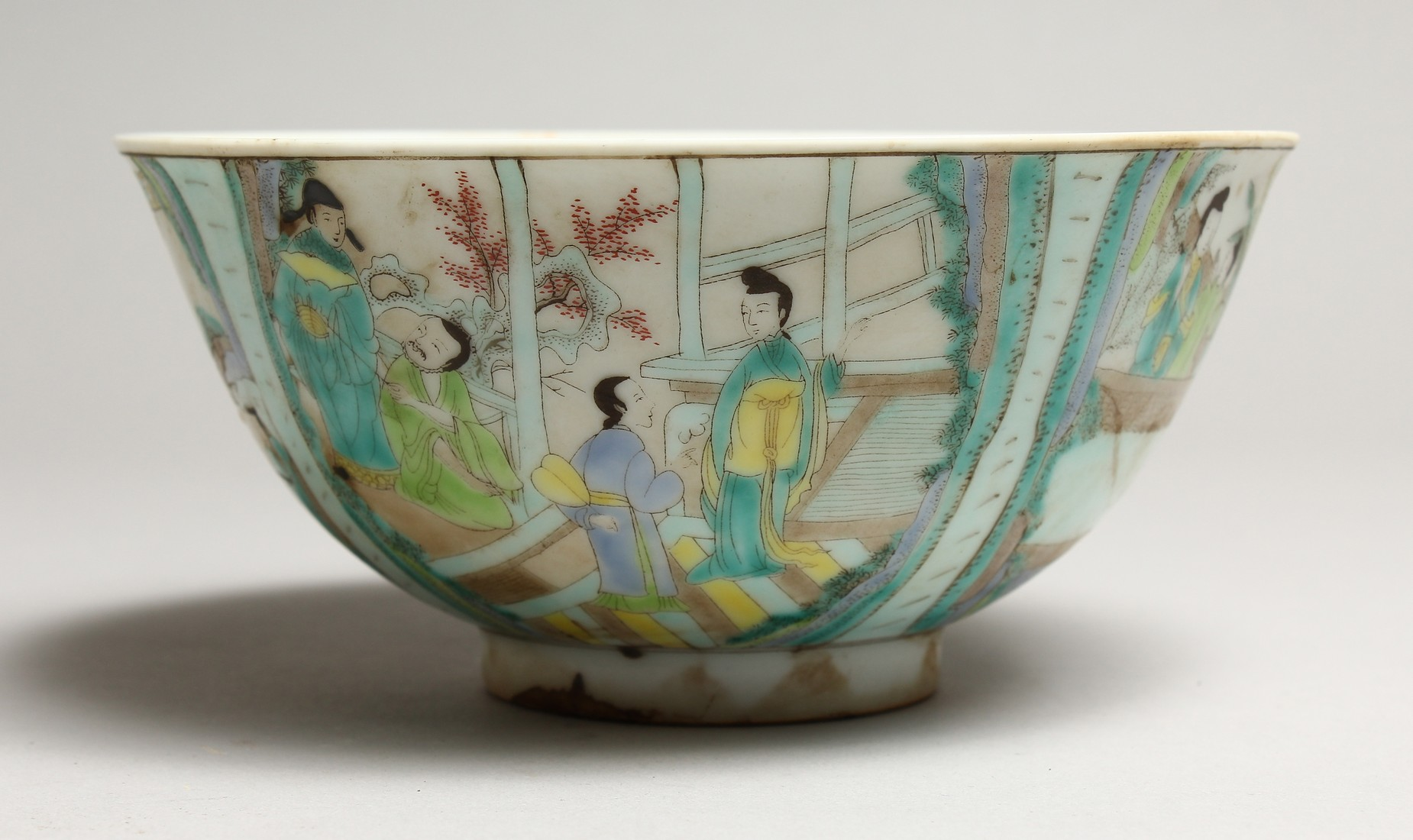 A CHINESE FAMILLE VERTE PORCELAIN BOWL, painted with figures in a landscape. 6.25ins diameter.