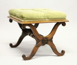 A GOOD 19TH CENTURY ROSEWOOD STOOL with button upholstered overstuffed seat, 'X' shape ends united