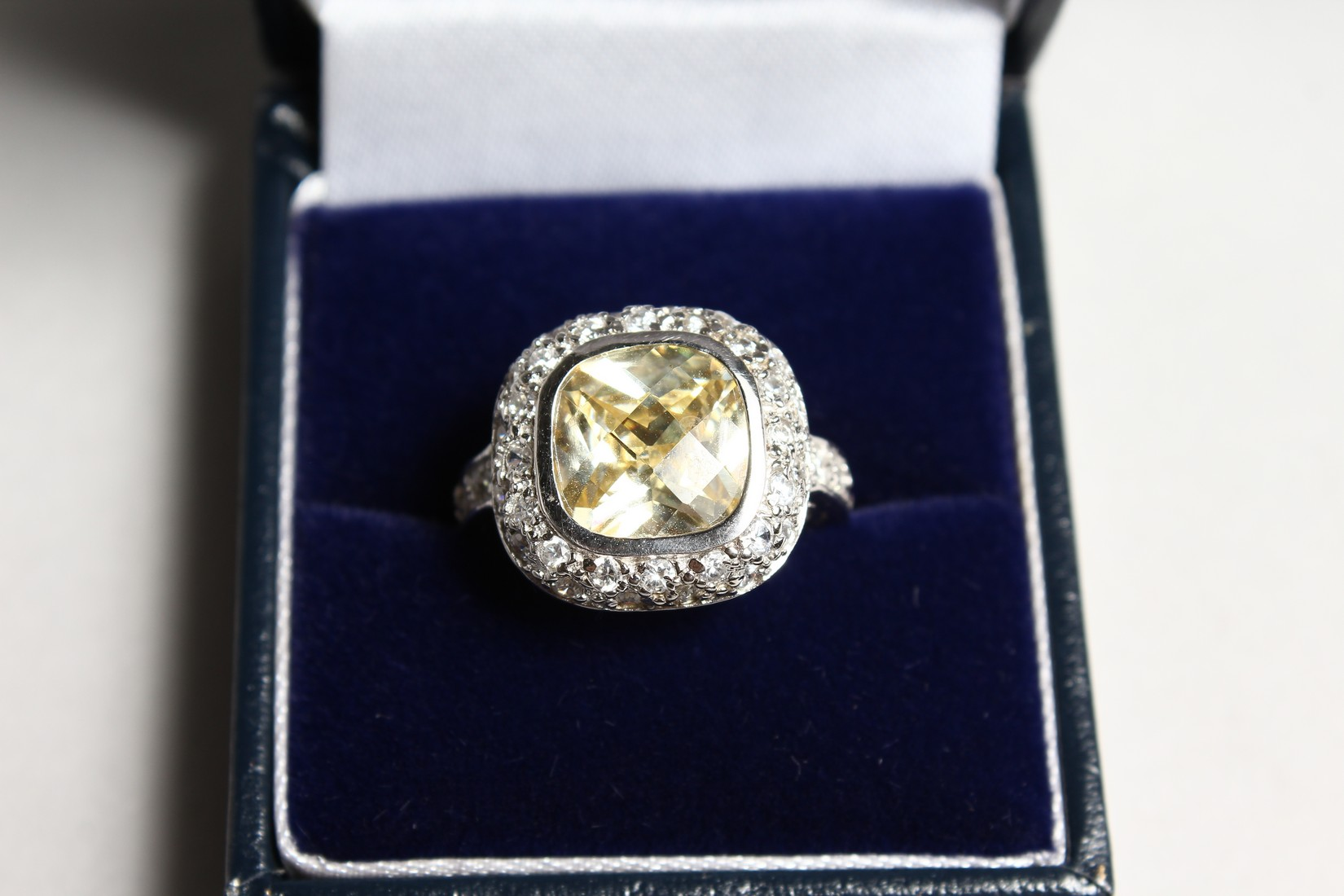 A SILVER CZ AND YELLOW RING - Image 2 of 3