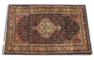 A GOOD PERSIAN RUG, 20TH CENTURY, blue ground, the central panel with stylised boteh design. 6ft