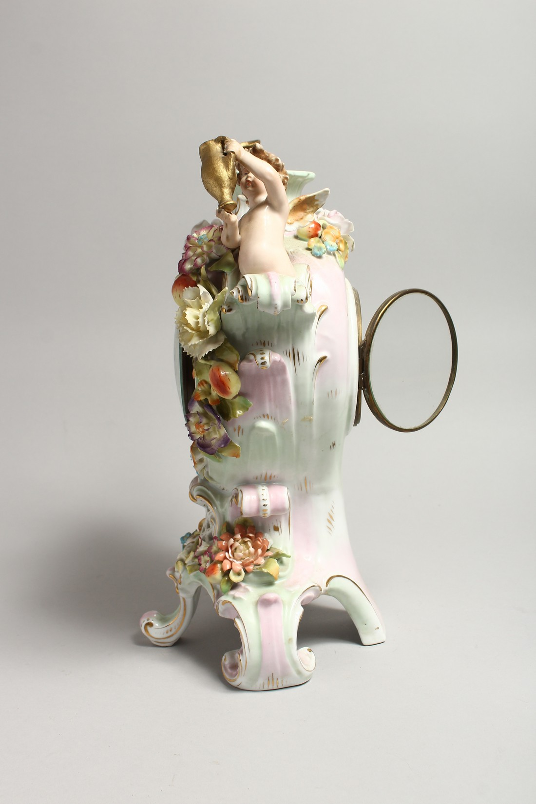 A CONTINENTAL PORCELAIN CUPID AND FLOWER ENCRUSTED CLOCK, with blue and white Roman numerals. - Image 2 of 7
