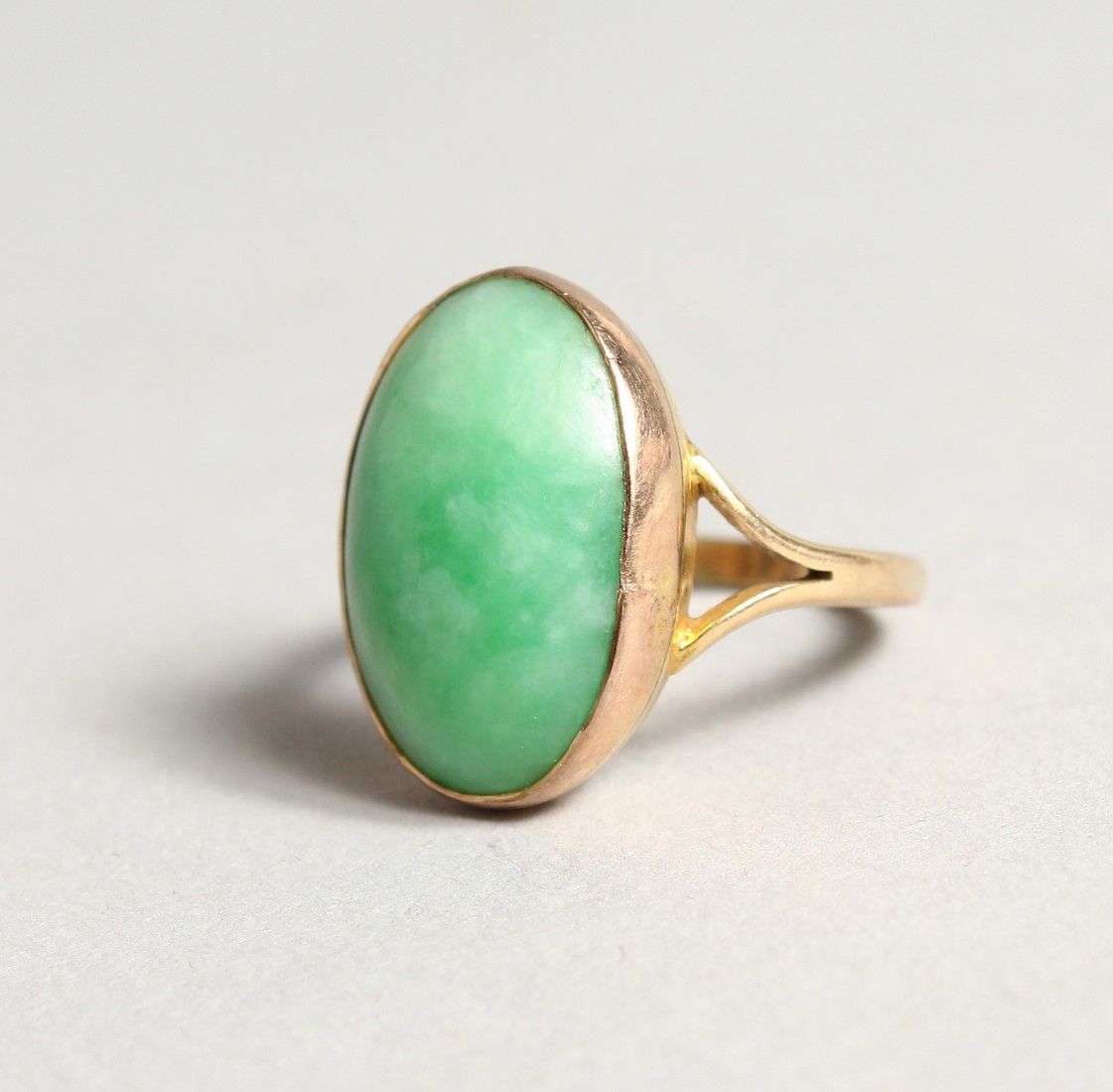 A GOLD AND JADE RING