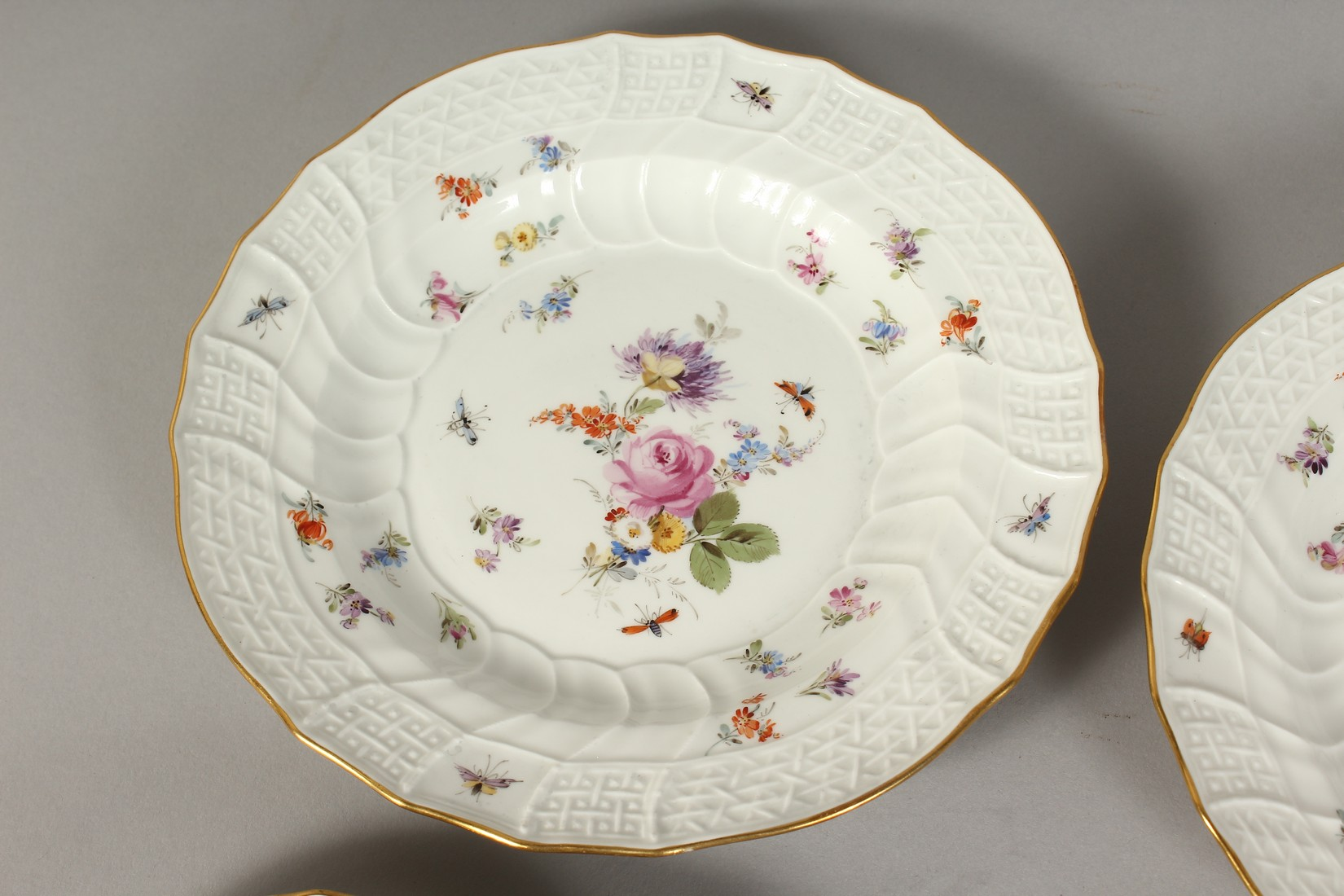 A SET OF EIGHT MEISSEN PORCELAIN DISHES with moulded gilt edged rim, each painted with flowers and - Image 9 of 11