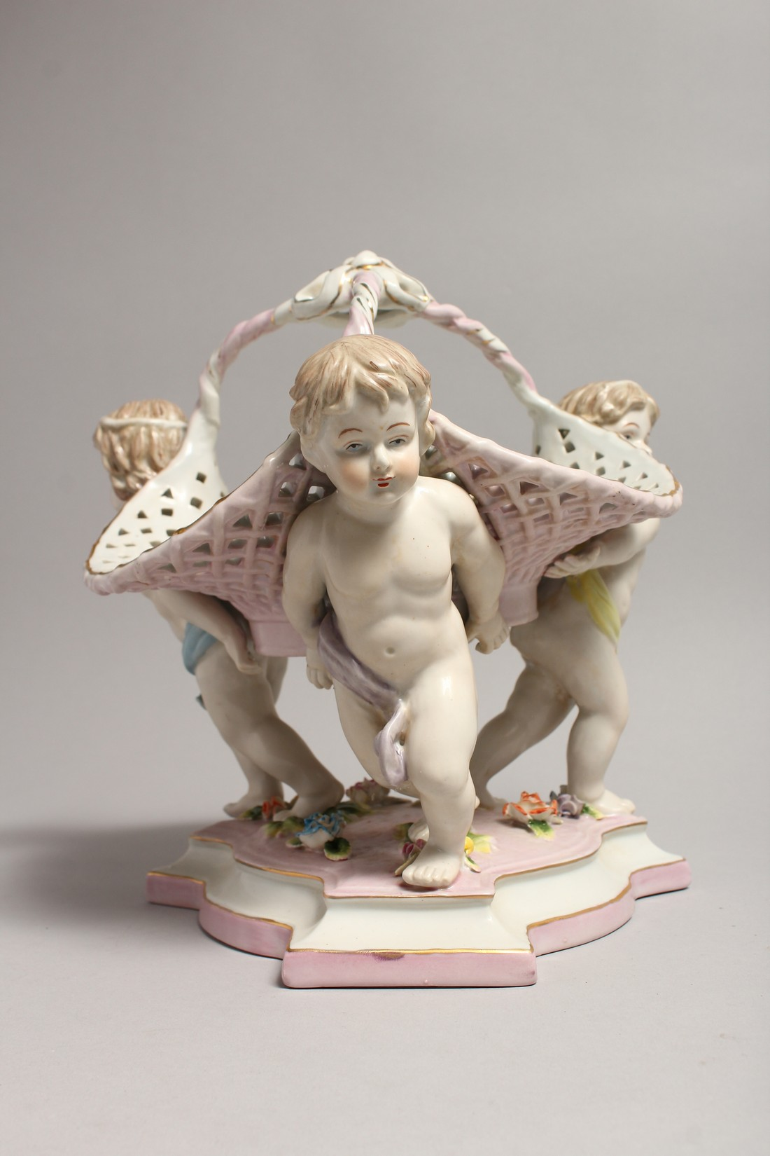A MEISSEN STYLE PORCELAIN BASKET supported by three cupids. 10ins high - Image 4 of 5