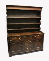 A GOOD 18TH CENTURY NORTH COUNTY OAK WELSH DRESSER the top with three shelves and hooks, the base