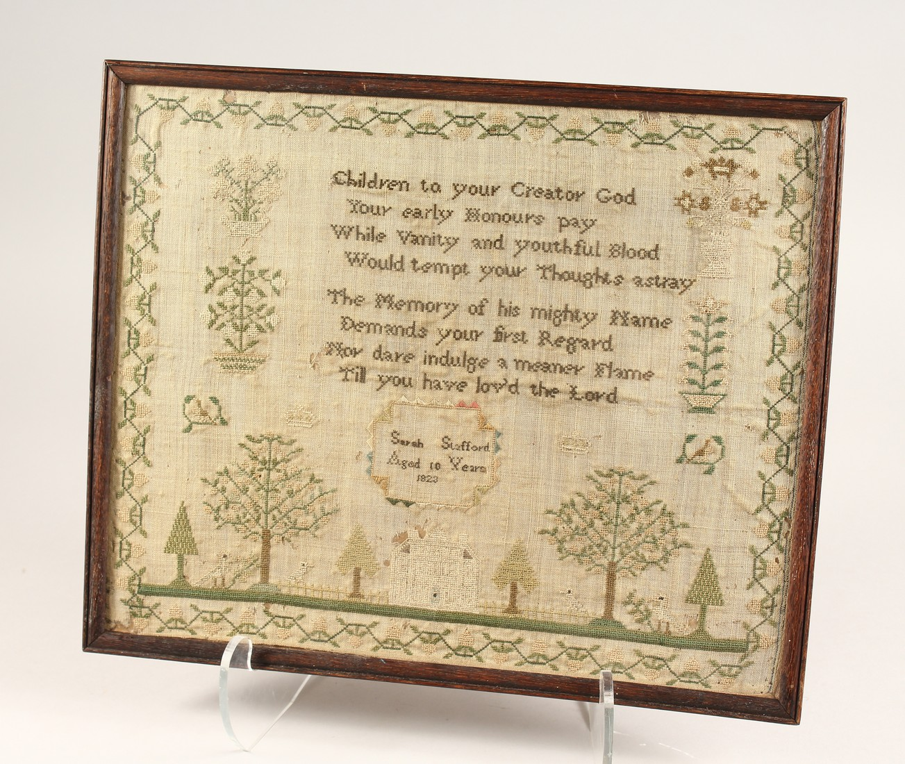 AN 1823 NEEDLEWORK SAMPLER by Sarah Stafford, age 10. 12.5ins x 5ins