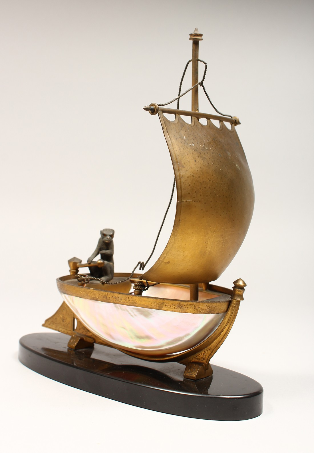 AN UNUSUAL LATE 19TH CENTURY FRENCH ORMOLU MOUNTED SHELL, mounted as a small sailing dinghy, a
