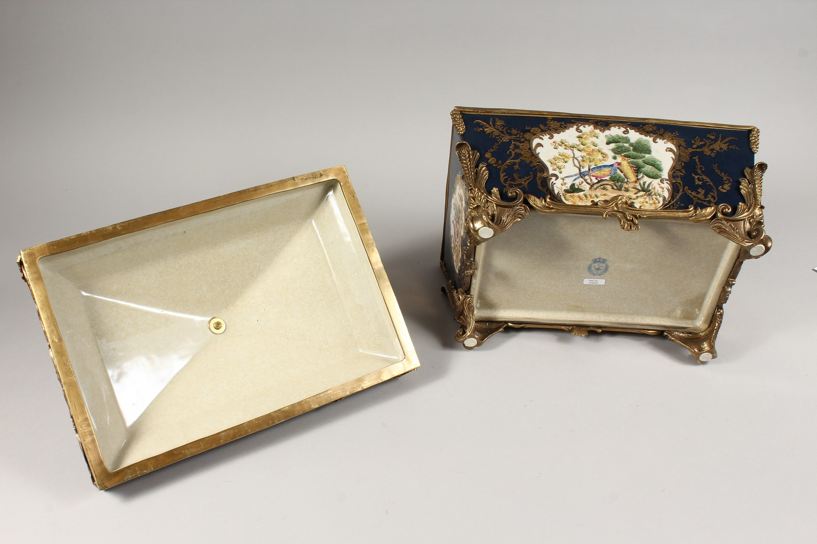 A DECORATIVE PORCELAIN AND ORMOLU MOUNTED SEVRES STYLE CASKET AND COVER. 15ins long - Image 4 of 5